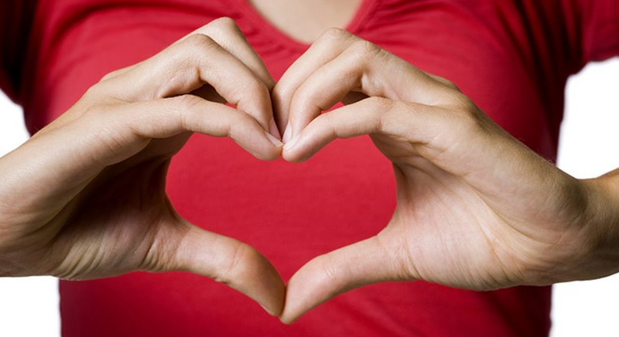 Hand making heart
